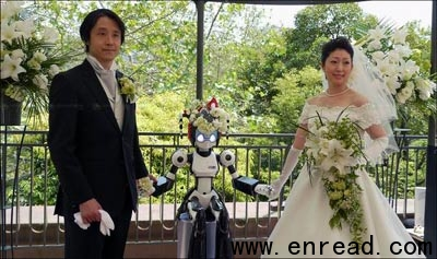 I-Fairy, a four-foot tall seated robot with flashing eyes and plastic pigtails, directs a wedding ceremony for groom TomohiroShibata 42, and bride Satoko Inouye, 36, at a Tokyo restaurant Sunday, May 16, 2010.